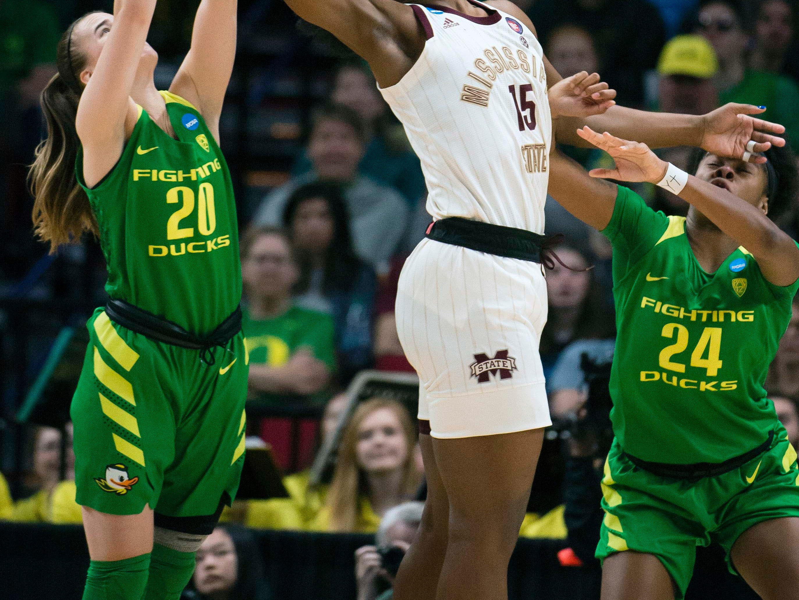Mississippi State Bulldogs center Teaira McCowan (15) battles for a rebound during the first half against Oregon Ducks guard Sabrina Ionescu (20) in the championship game of the Portland regional in the women's 2019 NCAA Tournament at Moda Center.