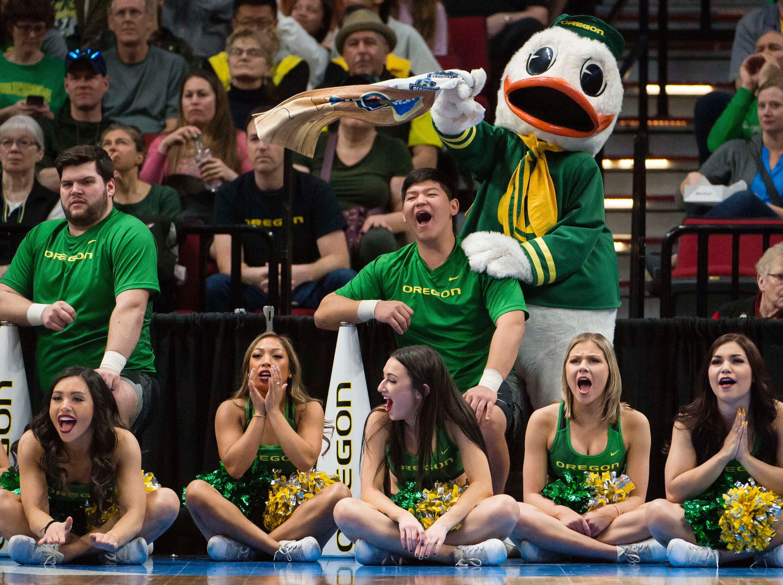 The Oregon Ducks cheer team scream to distract a Mississippi State Bulldogs player at the free throw line in the championship game of the Portland regional in the women's 2019 NCAA Tournament at Moda Center. The Oregon Ducks beat the Mississippi State Bulldogs 88-84.