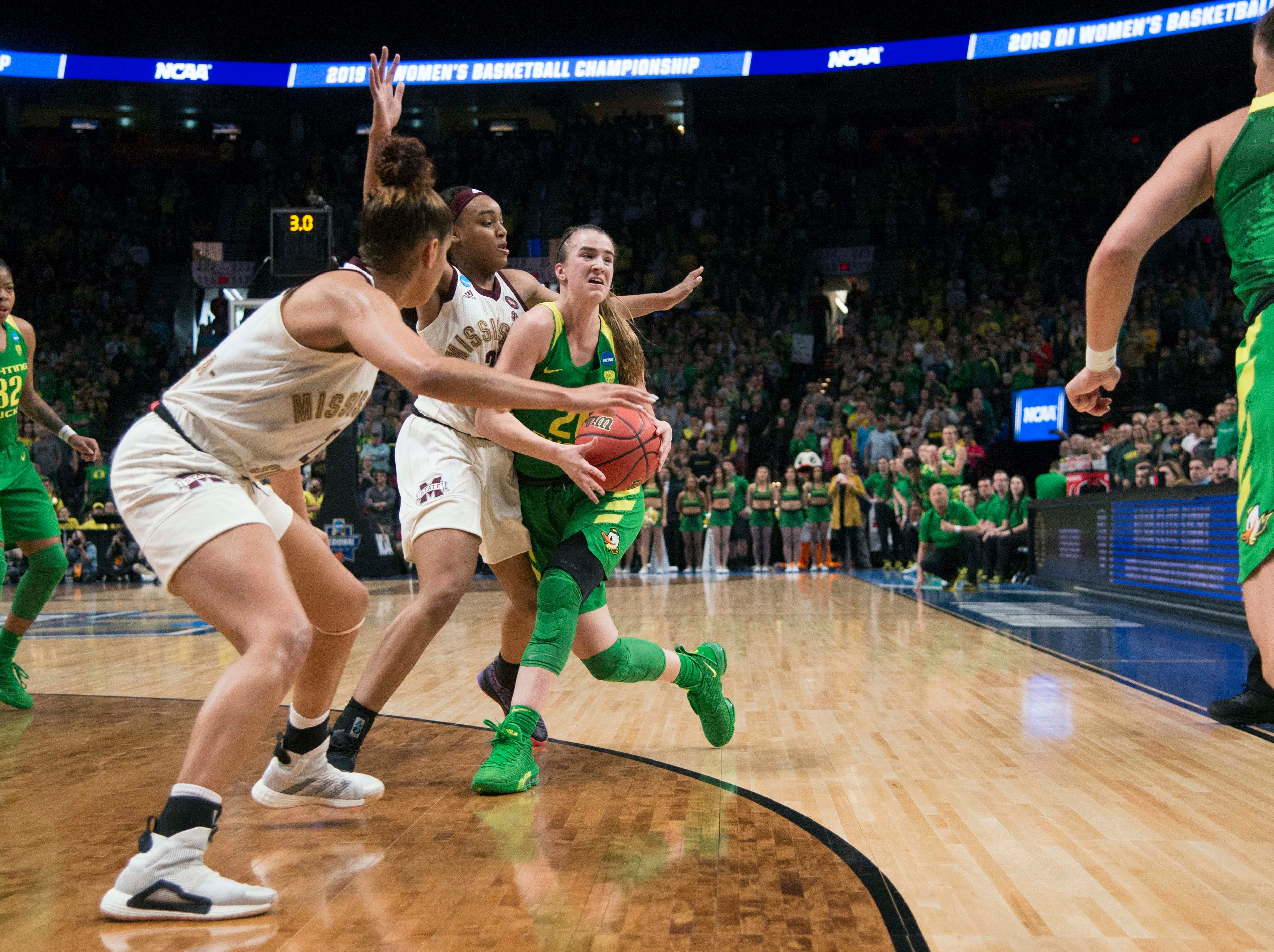 Oregon Ducks guard Sabrina Ionescu (20) runs looks for an outlet pass against Mississippi State Bulldogs guard Bre'Amber Scott (23) during the first half in the championship game of the Portland regional in the women's 2019 NCAA Tournament at Moda Center.