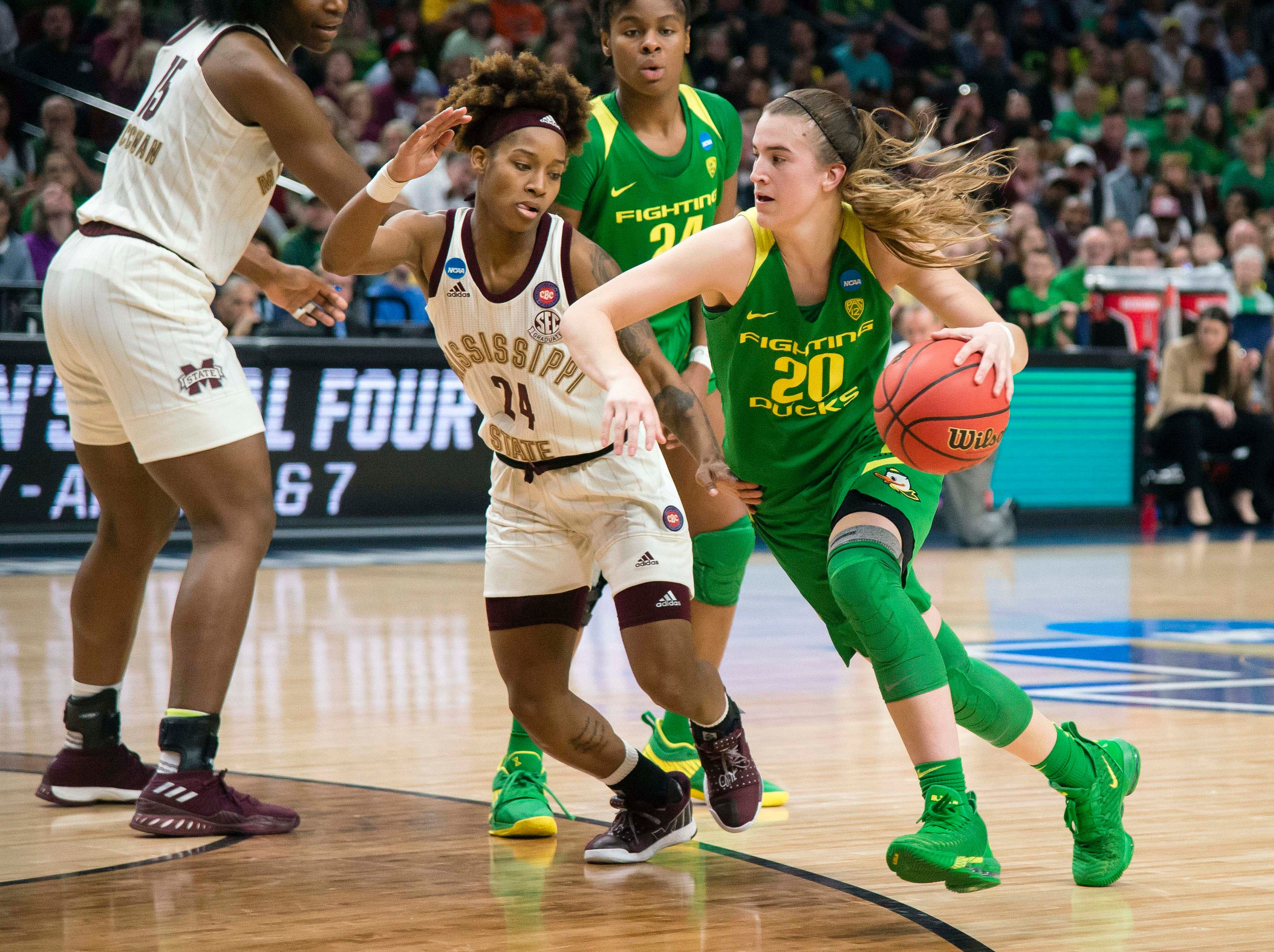 Oregon Ducks guard Sabrina Ionescu (20) drives past Mississippi State Bulldogs guard Jordan Danberry (24) during the second half in the championship game of the Portland regional in the women's 2019 NCAA Tournament at Moda Center. The Oregon Ducks beat the Mississippi State Bulldogs 88-84.