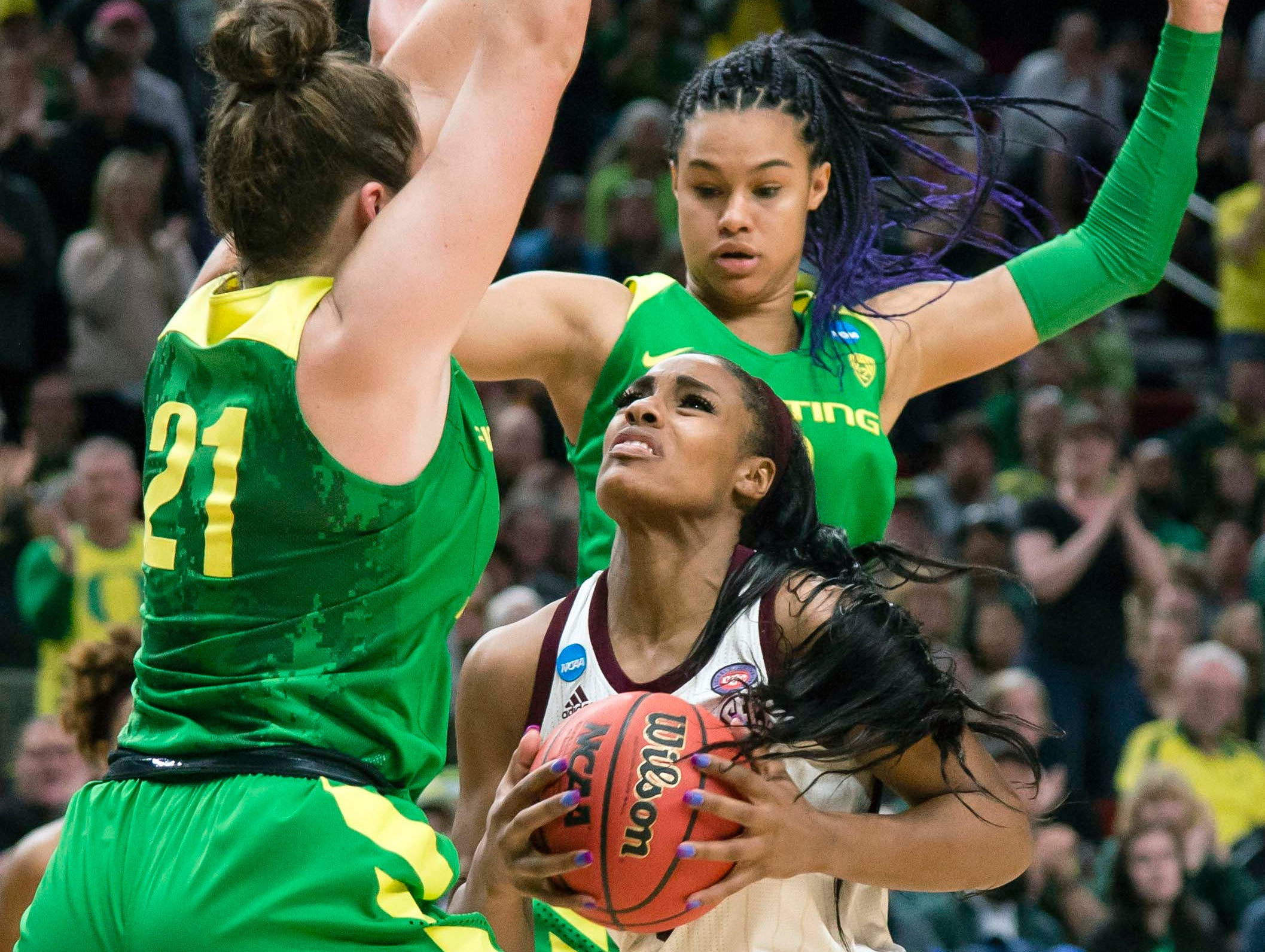 Mississippi State Bulldogs forward Anriel Howard (5) is double teamed by Oregon Ducks forward Erin Boley (21) and forward Satou Sabally (0) during the second half in the championship game of the Portland regional in the women's 2019 NCAA Tournament at Moda Center. The Oregon Ducks beat the Mississippi State Bulldogs 88-84.