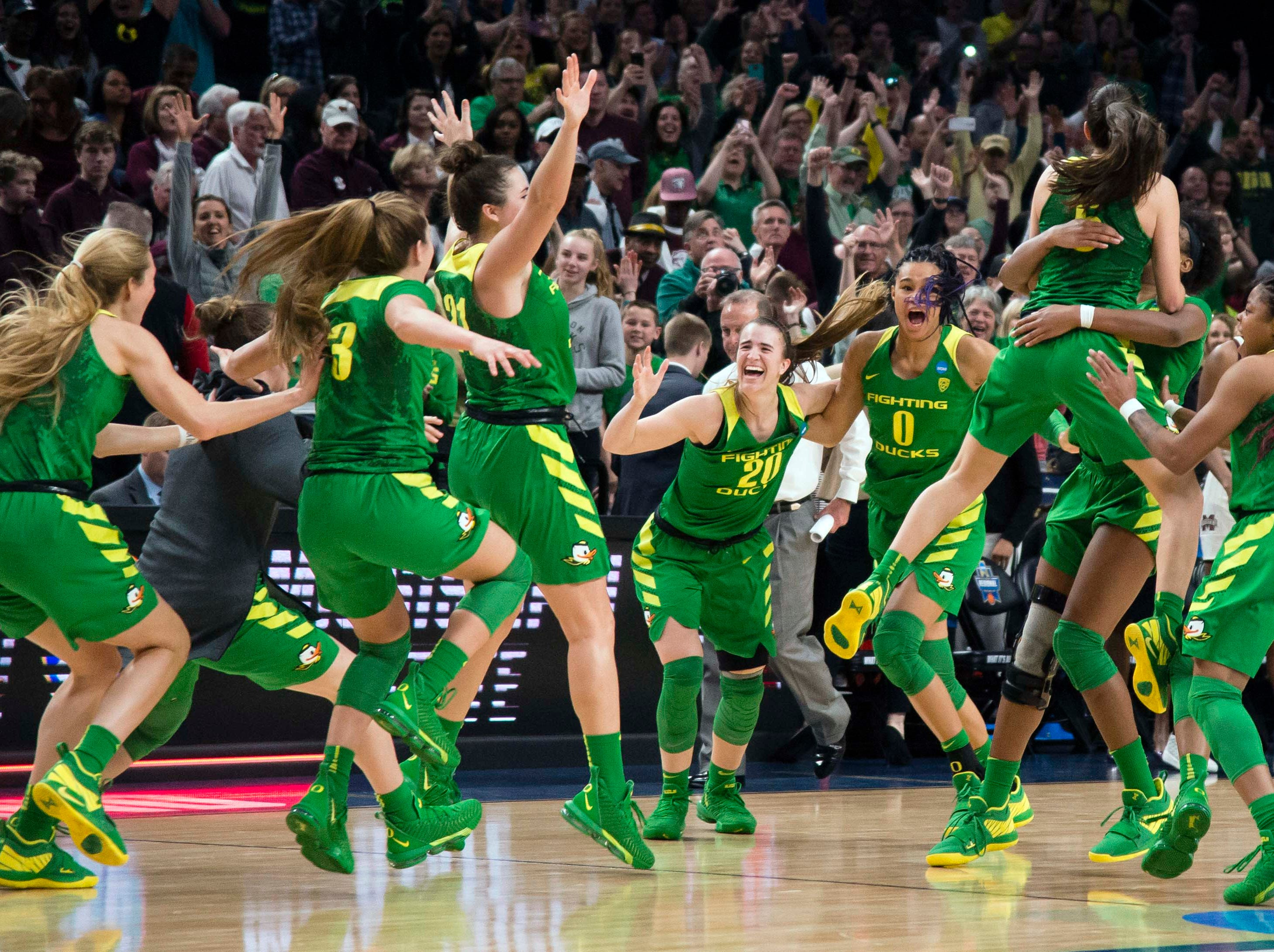 Oregon Ducks guard Sabrina Ionescu (20) and forward Satou Sabally (0) celebrate after a game against the Mississippi State Bulldogs in the championship game of the Portland regional in the women's 2019 NCAA Tournament at Moda Center. The Oregon Ducks beat the Mississippi State Bulldogs 88-84.