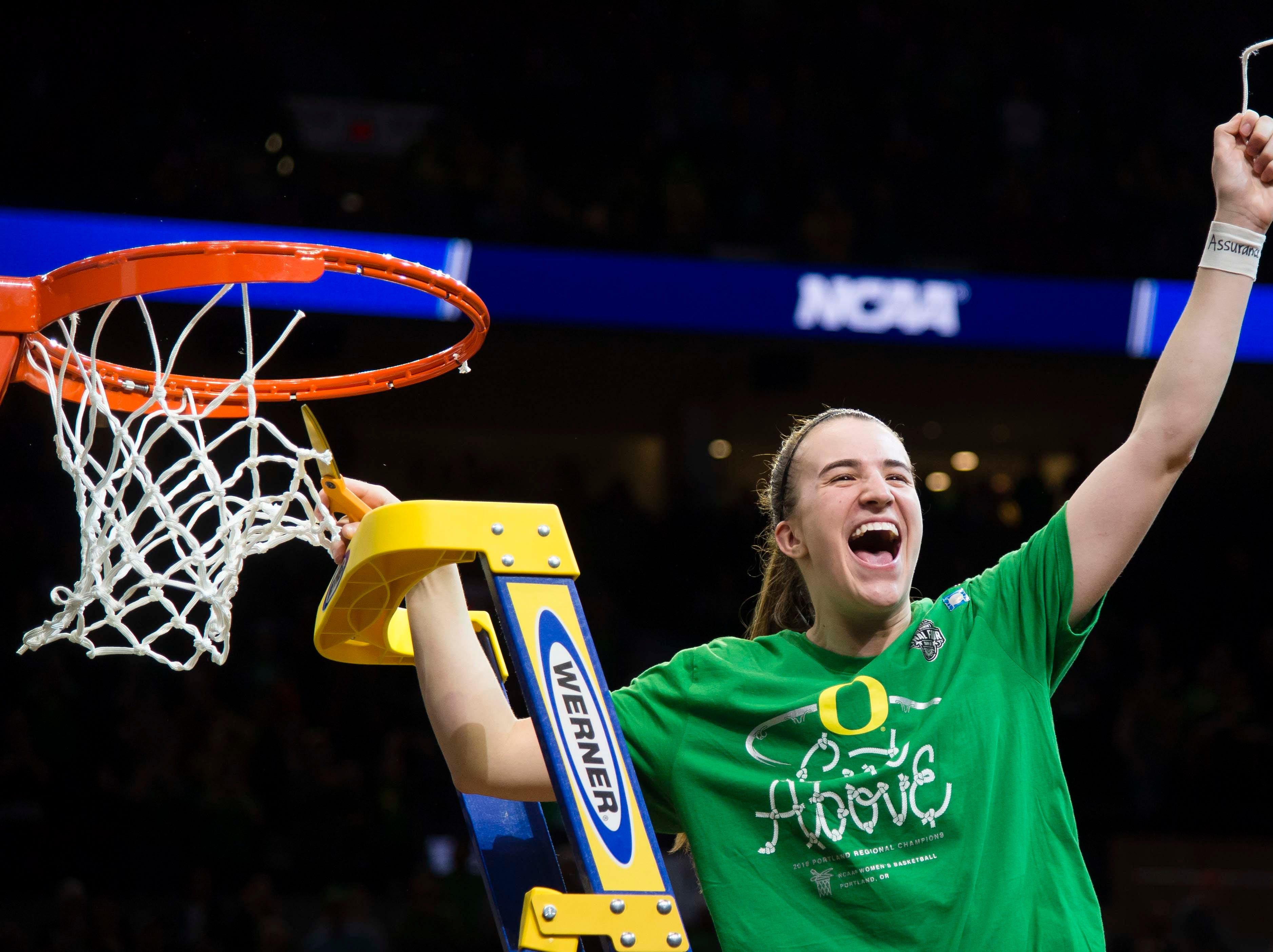 Oregon Ducks guard Sabrina Ionescu (20) cuts the net after a game against the Mississippi State Bulldogs in the championship game of the Portland regional in the women's 2019 NCAA Tournament at Moda Center. The Oregon Ducks beat the Mississippi State Bulldogs 88-84.