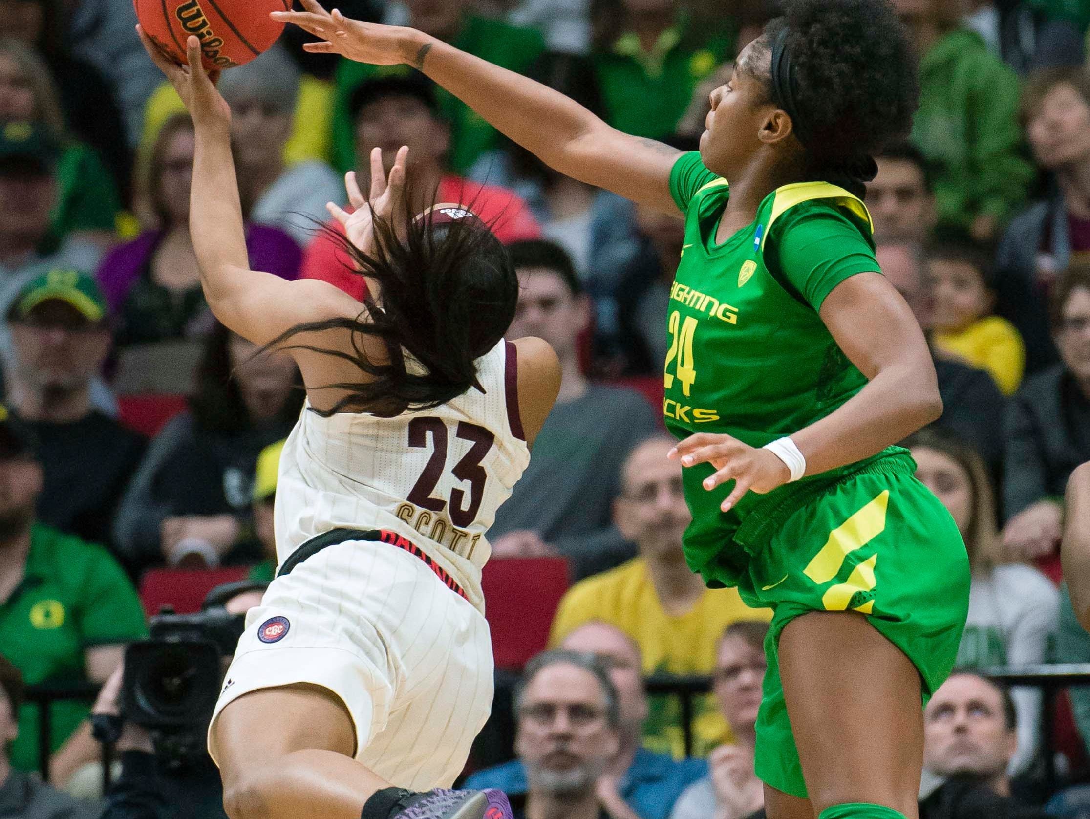 Oregon Ducks forward Ruthy Hebard (24) blocks a shot by Mississippi State Bulldogs guard Bre'Amber Scott (23) during the second half in the championship game of the Portland regional in the women's 2019 NCAA Tournament at Moda Center. The Oregon Ducks beat the Mississippi State Bulldogs 88-84.