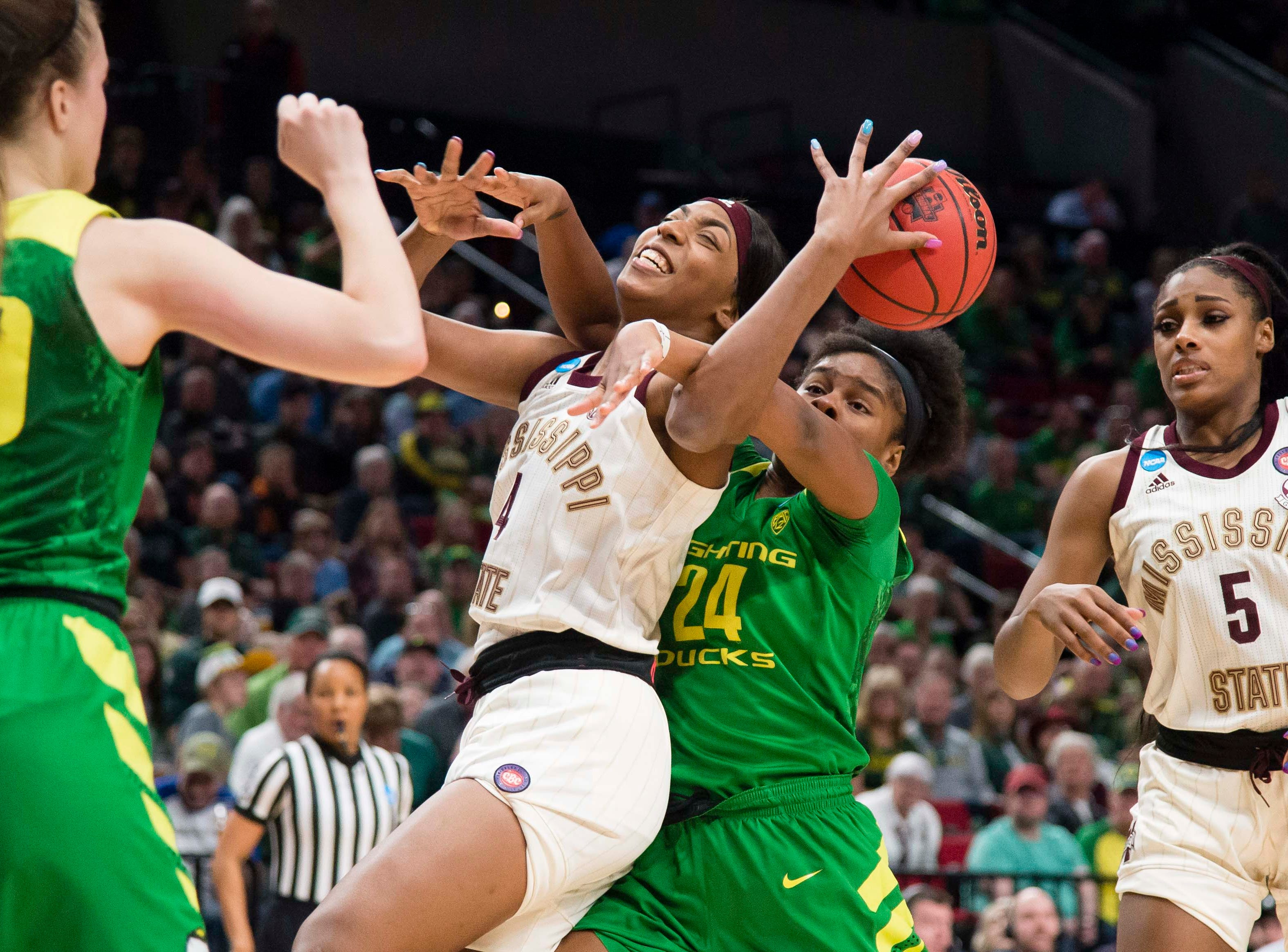 Mississippi State Bulldogs forward Jessika Carter (4) and Oregon Ducks forward Ruthy Hebard (24) battle for a rebound during the second half in the championship game of the Portland regional in the women's 2019 NCAA Tournament at Moda Center. The Oregon Ducks beat the Mississippi State Bulldogs 88-84.