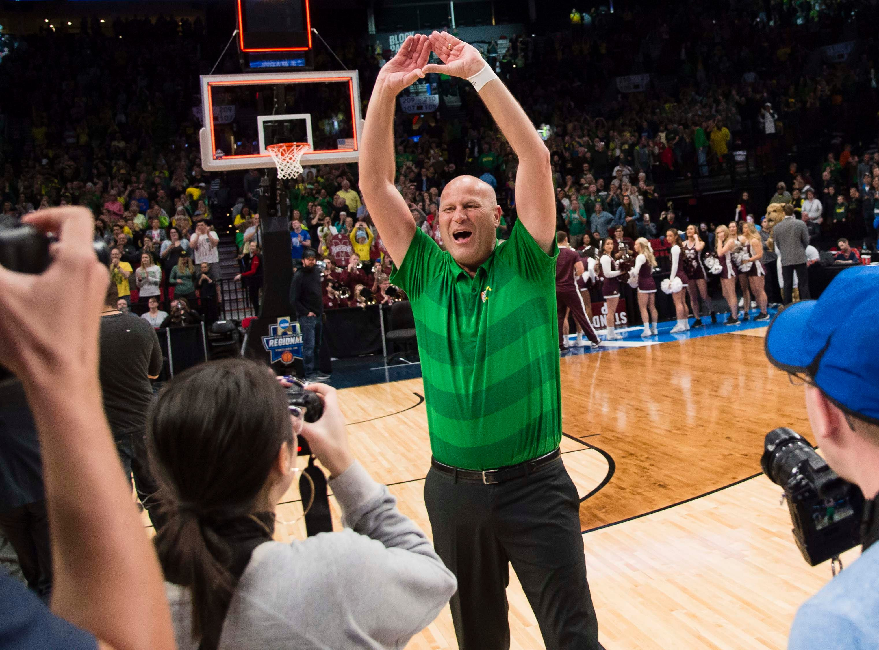 Oregon Ducks head coach Kelly Graves celebrates after a game against the Mississippi State Bulldogs in the championship game of the Portland regional in the women's 2019 NCAA Tournament at Moda Center. The Oregon Ducks beat the Mississippi State Bulldogs 88-84.