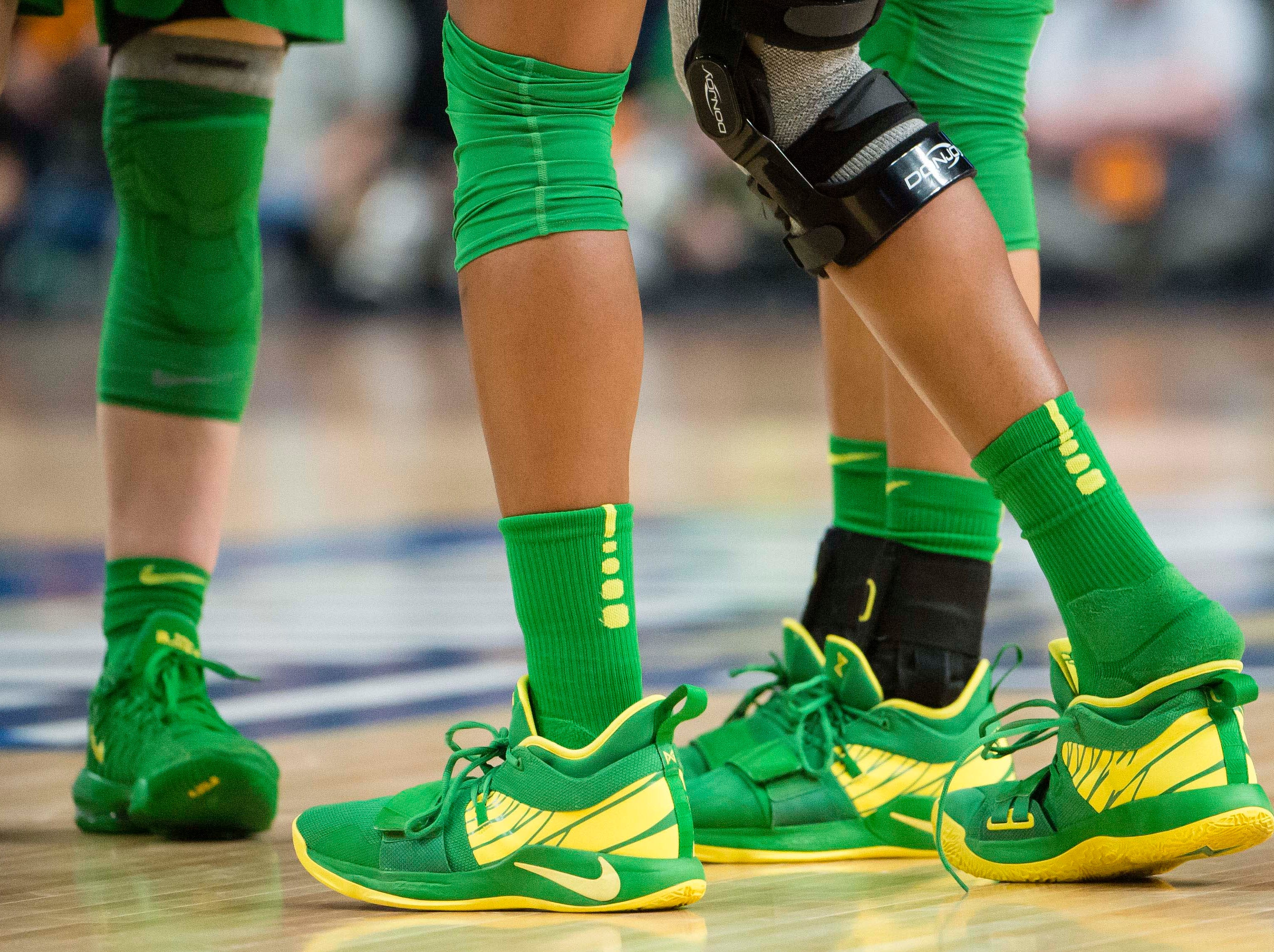 Oregon Ducks forward Ruthy Hebard (24) puts her shoe back on after a play in the second half against the Mississippi State Bulldogs in the championship game of the Portland regional in the women's 2019 NCAA Tournament at Moda Center. The Oregon Ducks beat the Mississippi State Bulldogs 88-84.