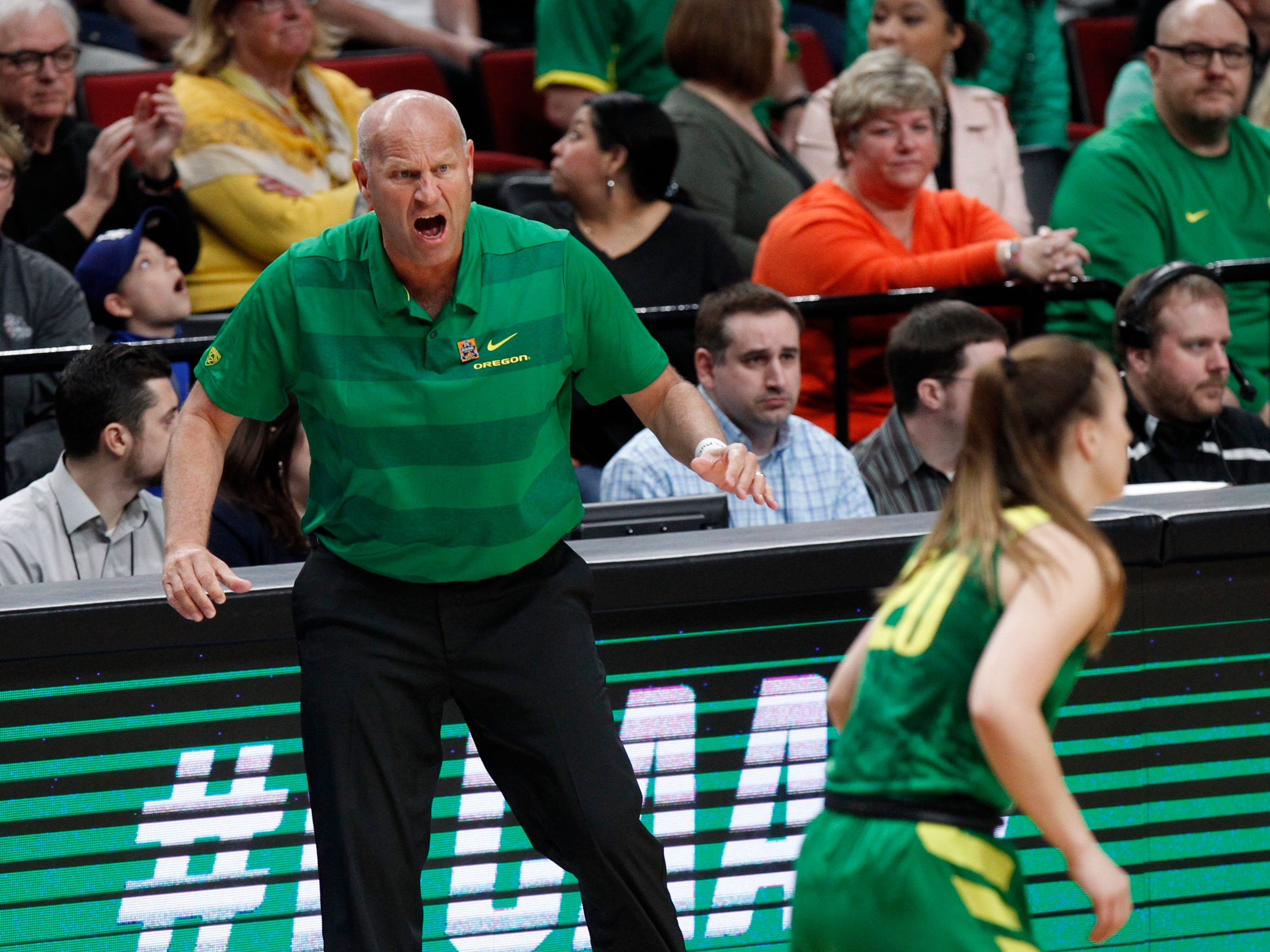 Oregon head coach Kelly Graves, left, shouts instructions to his team during the first half of a regional final against Mississippi State in the NCAA women's college basketball tournament Sunday, March 31, 2019, in Portland, Ore.