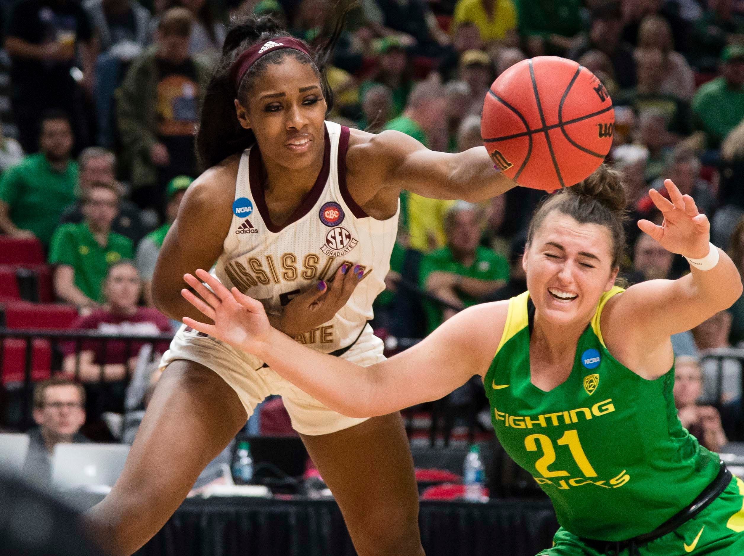 Mississippi State Bulldogs forward Anriel Howard (5) dives for a rebound against Oregon Ducks forward Erin Boley (21) during the second half in the championship game of the Portland regional in the women's 2019 NCAA Tournament at Moda Center. The Oregon Ducks beat the Mississippi State Bulldogs 88-84.