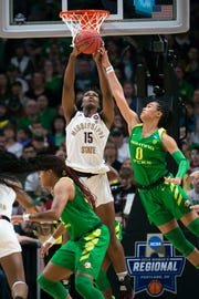 Mississippi State Bulldogs center Teaira McCowan (15) grabs a rebound during the first half against Oregon Ducks forward Satou Sabally (0) in the championship game of the Portland regional in the women's 2019 NCAA Tournament at Moda Center.