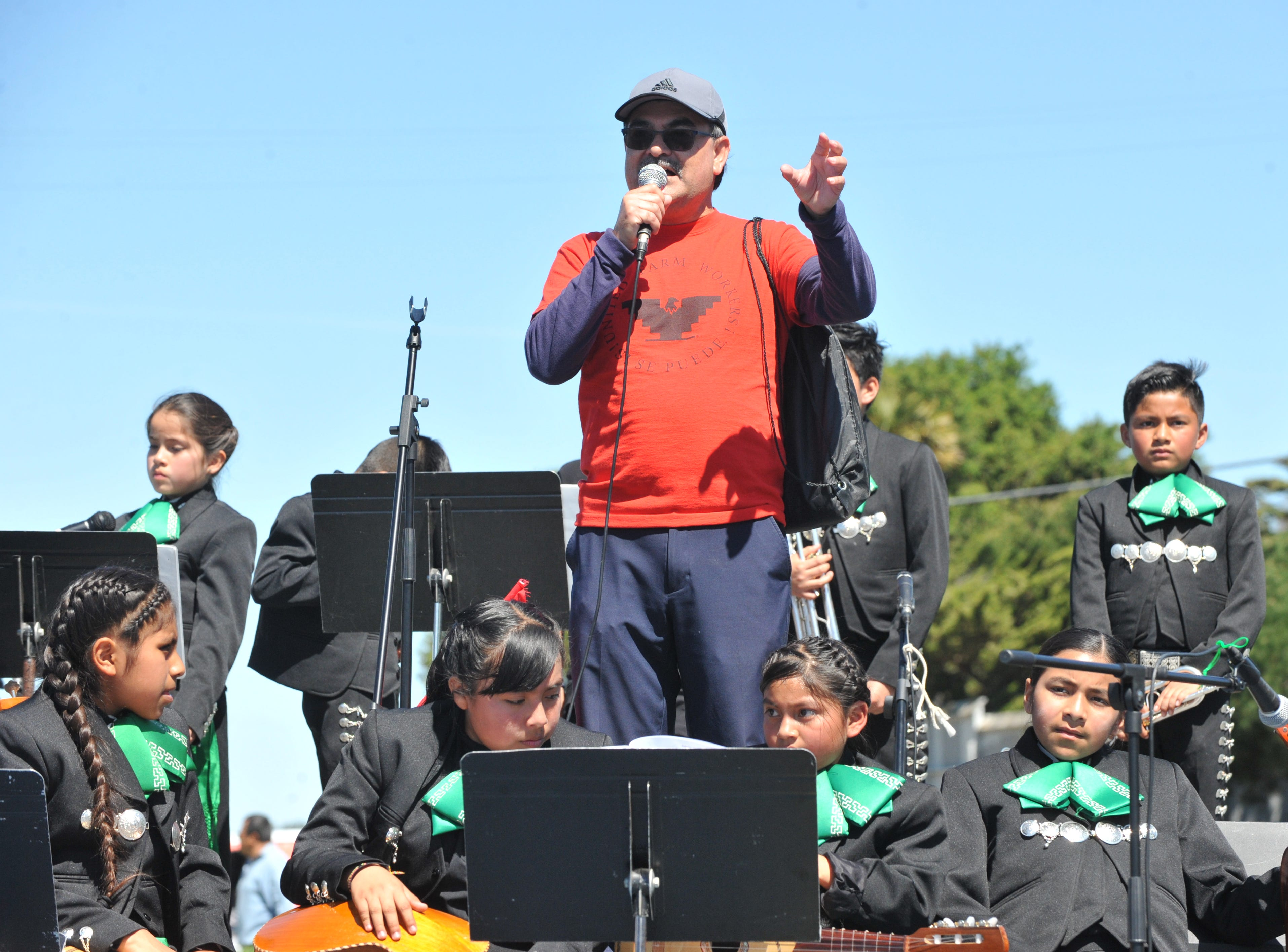 Lauro Barajas, regional director of the United Farm Workers, addresses marchers on March 31, 2019.