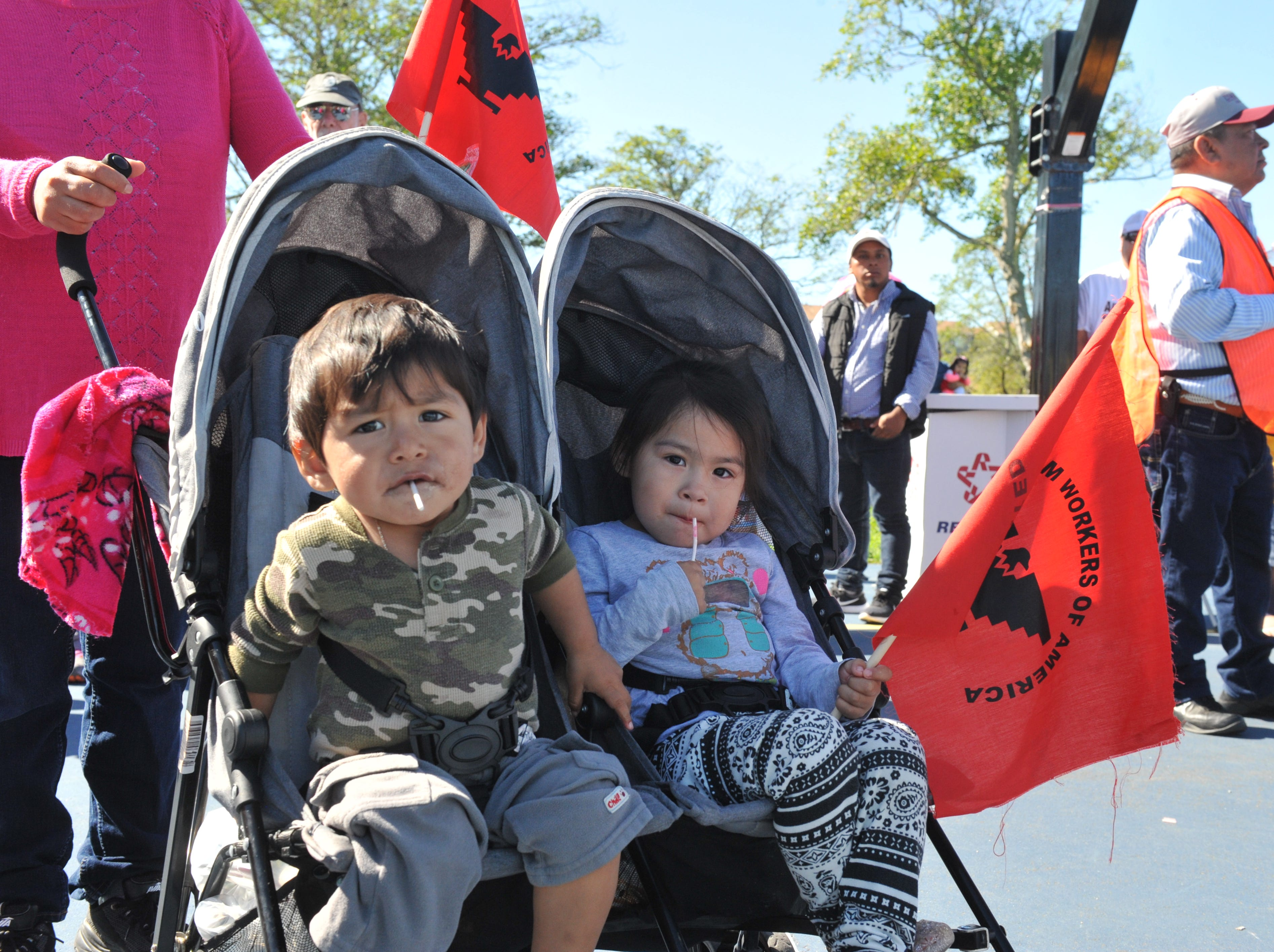 """Marchers organized by the United Farm Workers went through East Salinas on March 31, 2019, Cesar Chavez's 92nd birthday, to support the """"Blue Card"""" bill that would provide a pathway to citizenship for farmworkers in the U.S."""