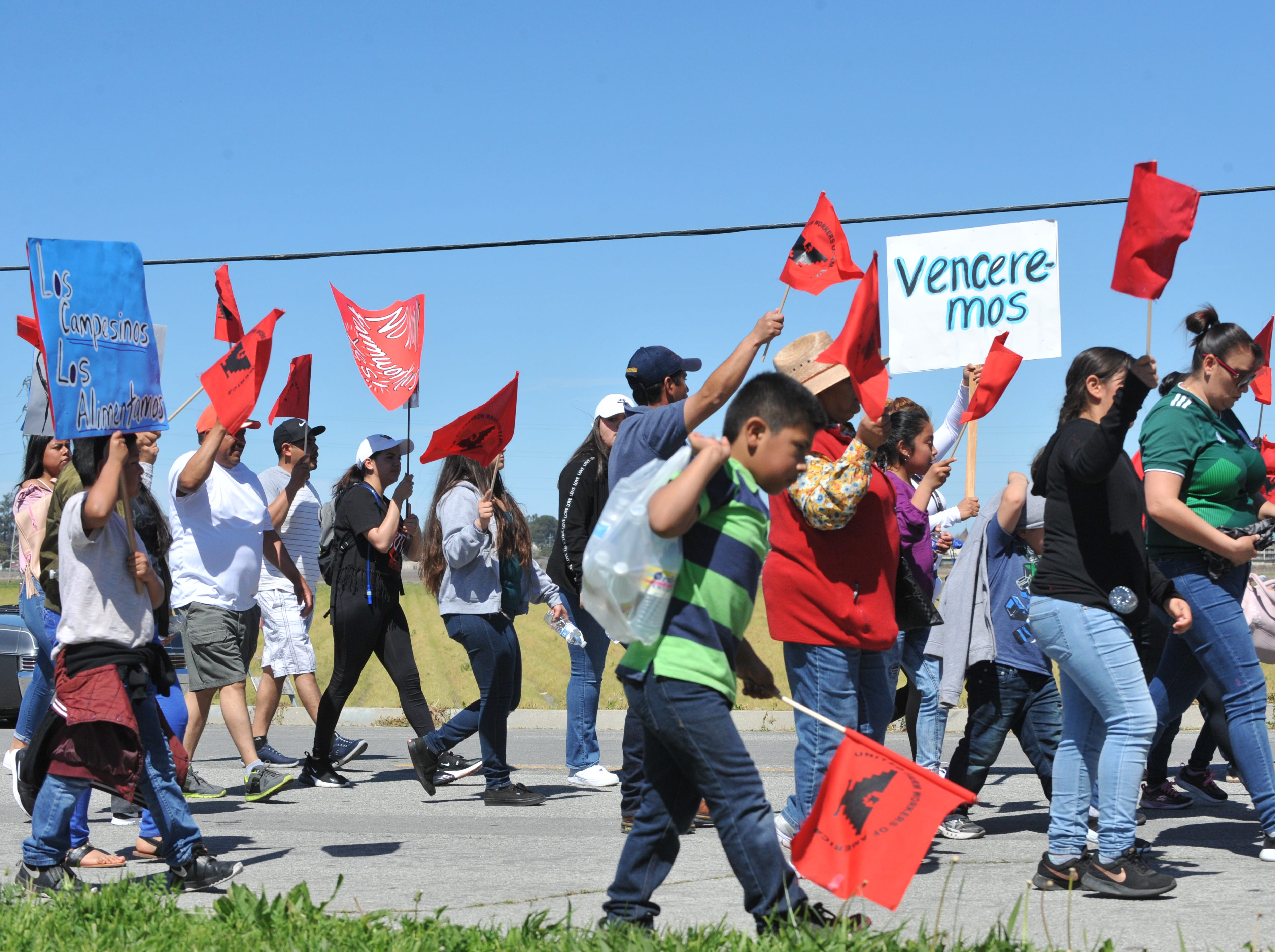 """Marchers organized by the United Farm Workers went through East Salinas on Cesar Chavez's birthday in support of the """"Blue Card"""" bill that would provide a pathway to citizenship for farmworkers."""