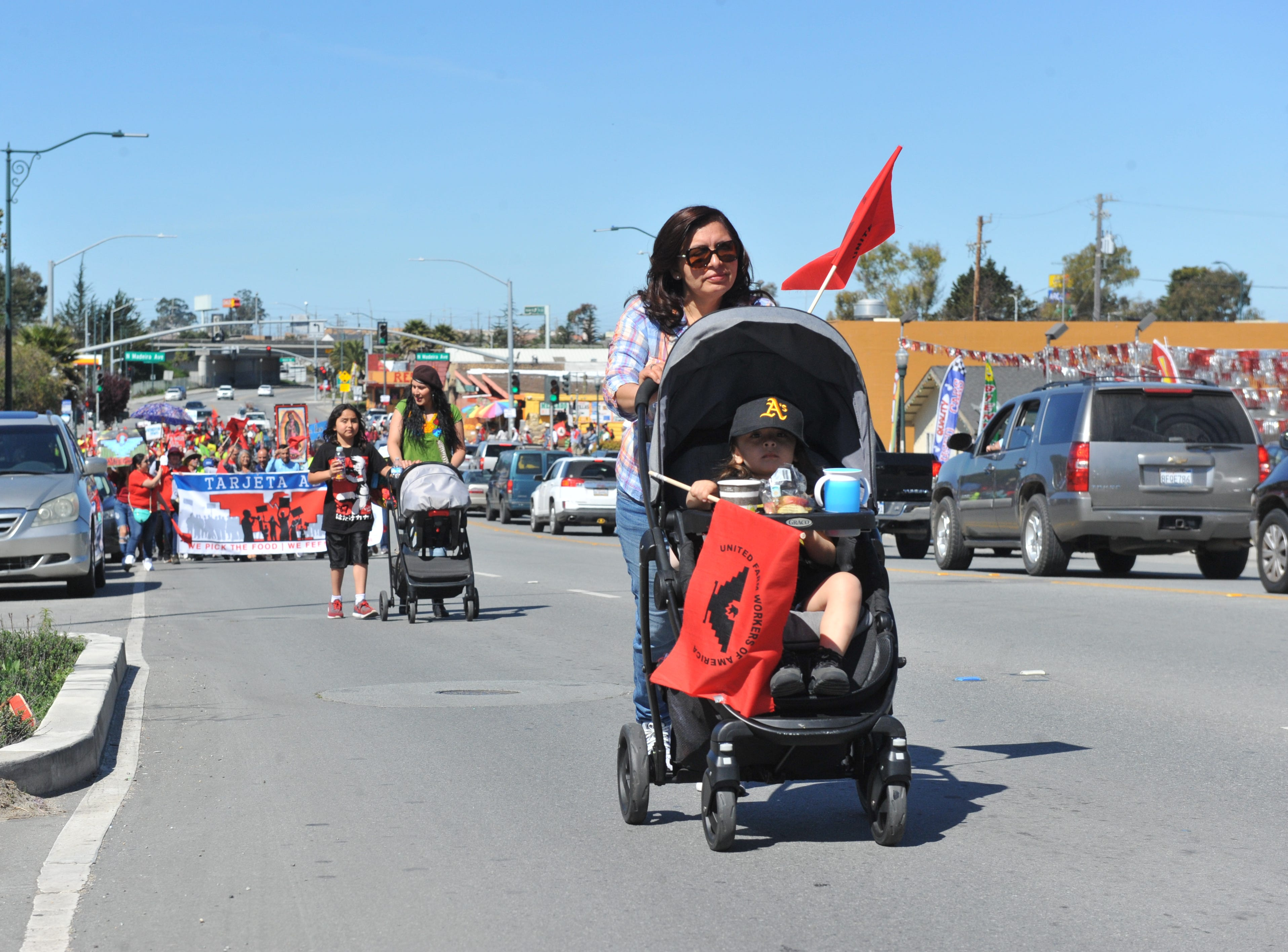 "Marchers organized by the United Farm Workers went through East Salinas on March 31, 2019, Cesar Chavez's 92nd birthday, to support the ""Blue Card"" bill that would provide a pathway to citizenship for farmworkers in the U.S."