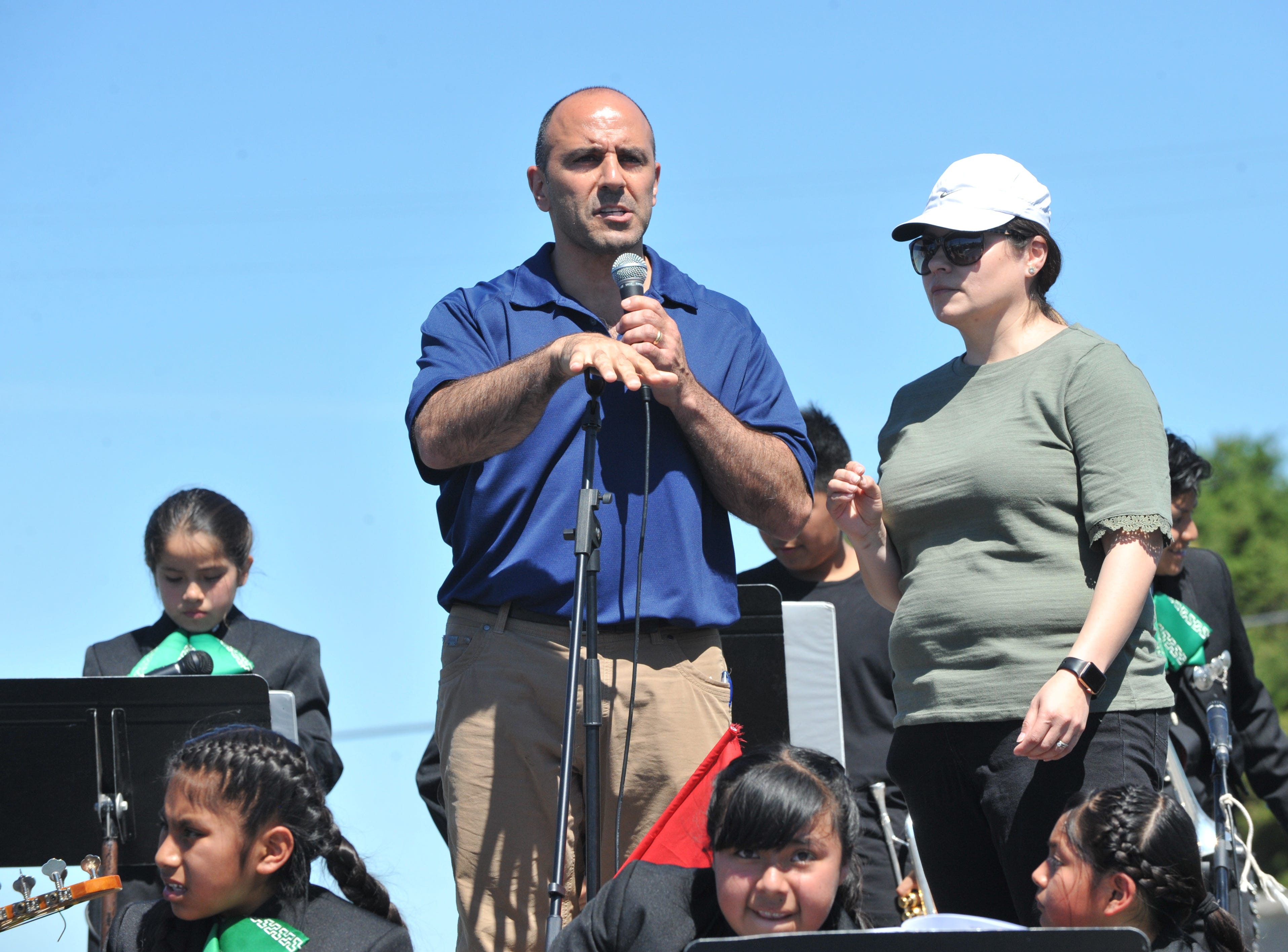 """Rep. Jimmy Panetta, local congressman and cosponsor of the """"Blue Card"""" bill,  addresses Sunday's marchers at Cesar Chavez Community Park in Salinas on March 31, 2019."""