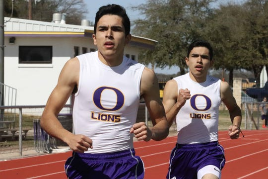 Ozona twin brothers Manuel and Humberto Torralba in action at the Ozona Relays earlier this season.