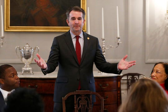 In this Friday, Feb. 22, file photo, Gov. Ralph Northam, center, greets members of the Richmond 34 and other African-American leaders for a breakfast at the Governors Mansion at the Capitol in Richmond, Va.