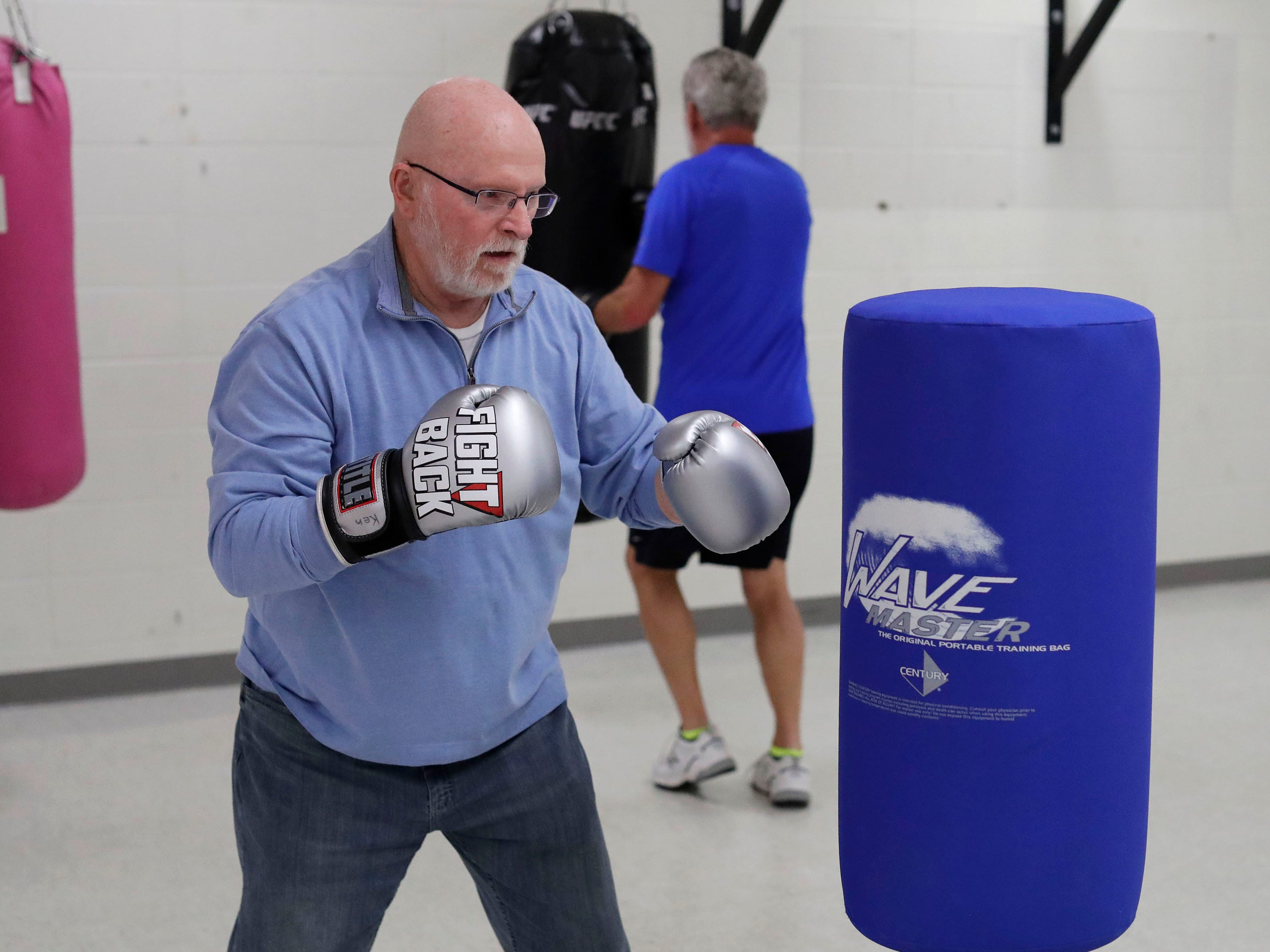 Ken Pipping of Elkhart Lake, Wis, gets in his boxing routine during the Fighting Parkinson's class at the YMCA, Tuesday, March 26, 2019, in Sheboygan, Wis.