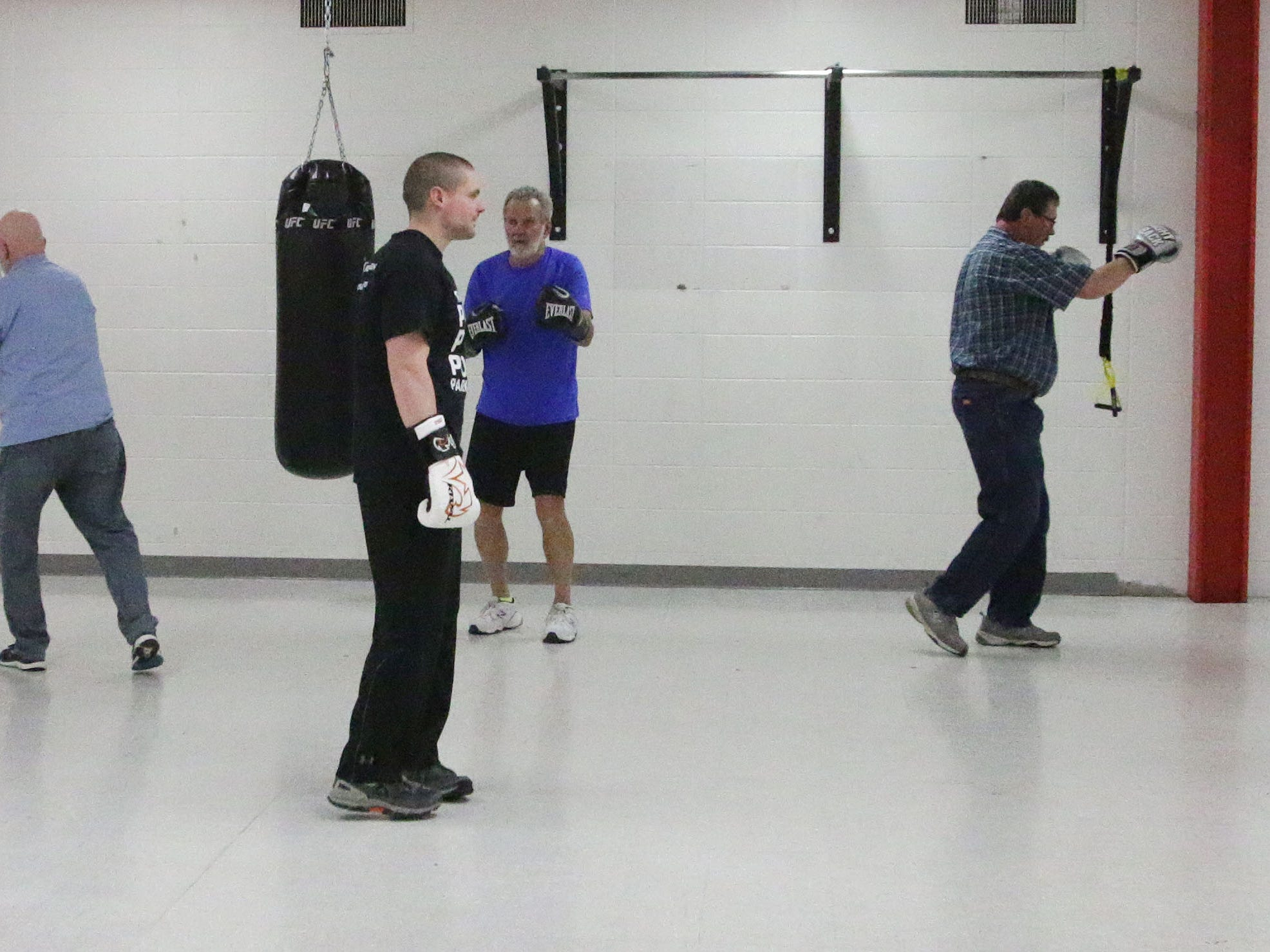 Fighting Parkinson's instructor Matt Glenzer, center, supervises the members of the class, Tuesday, March 26, 2019, in Sheboygan, Wis.