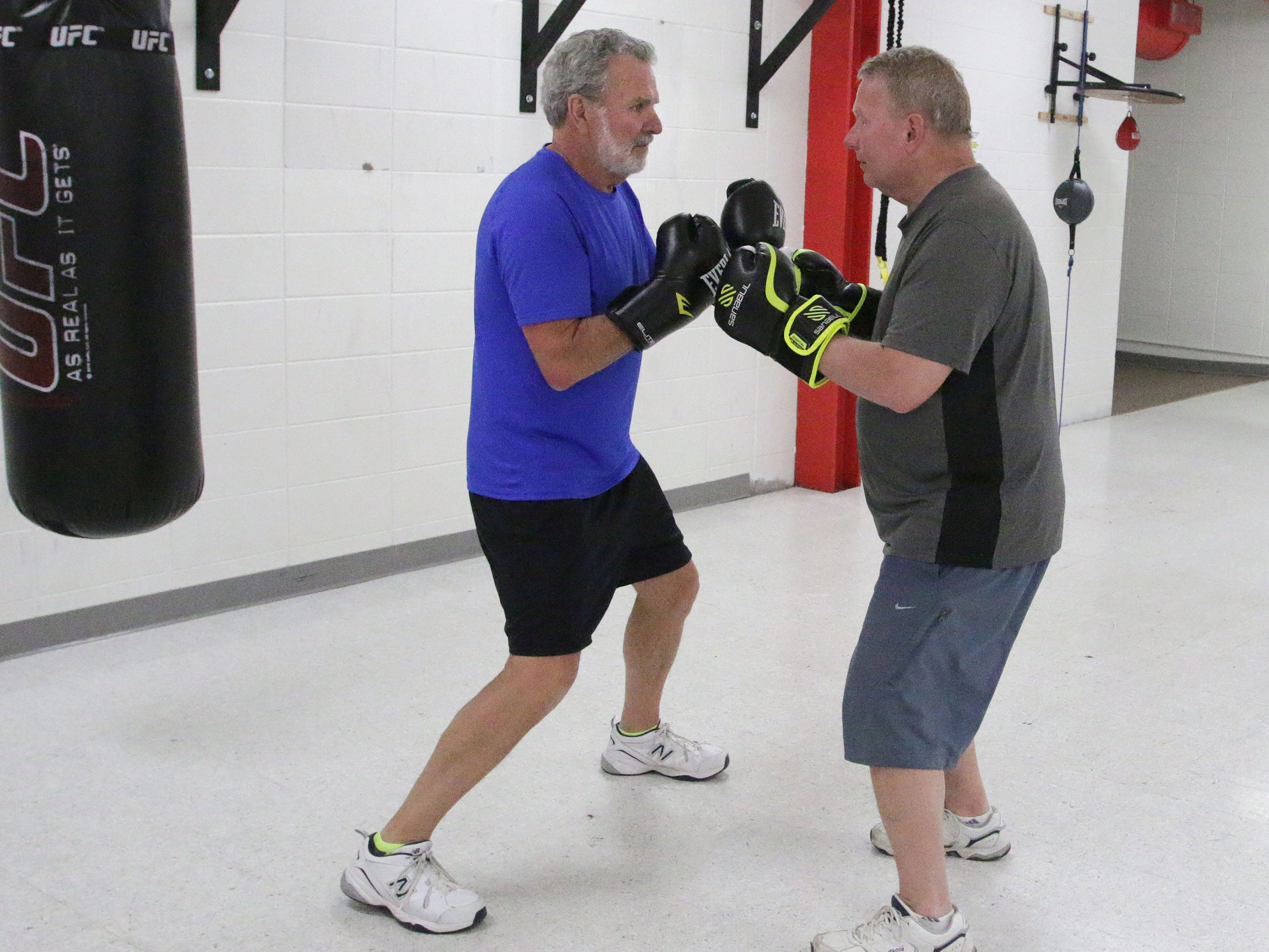 YMCA Fighting Parkinson's class members Larry Boll, left, and Kevin May practice on improving their footwork during the class, Tuesday, March 26, 2019, in Sheboygan, Wis.