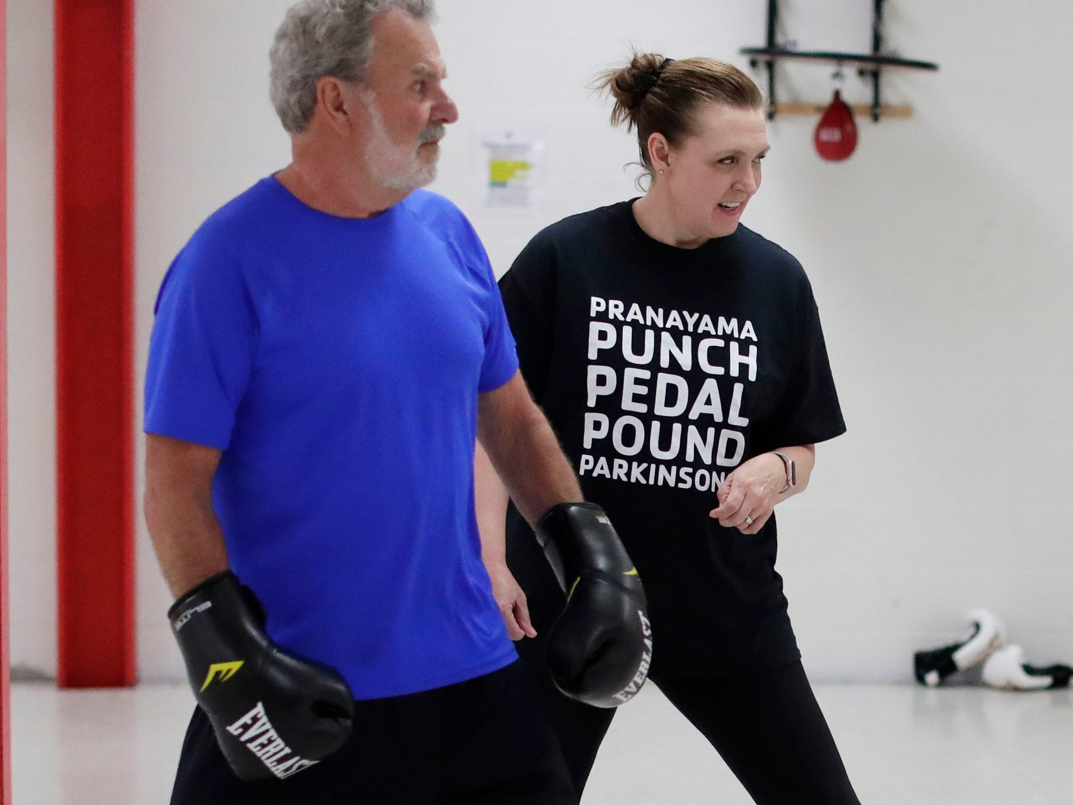Larry Boll, left, and instructor Jana Adams get in some step action during the Fighting Parkinson's class, Tuesday, March 21, 2019, in Sheboygan, Wis.