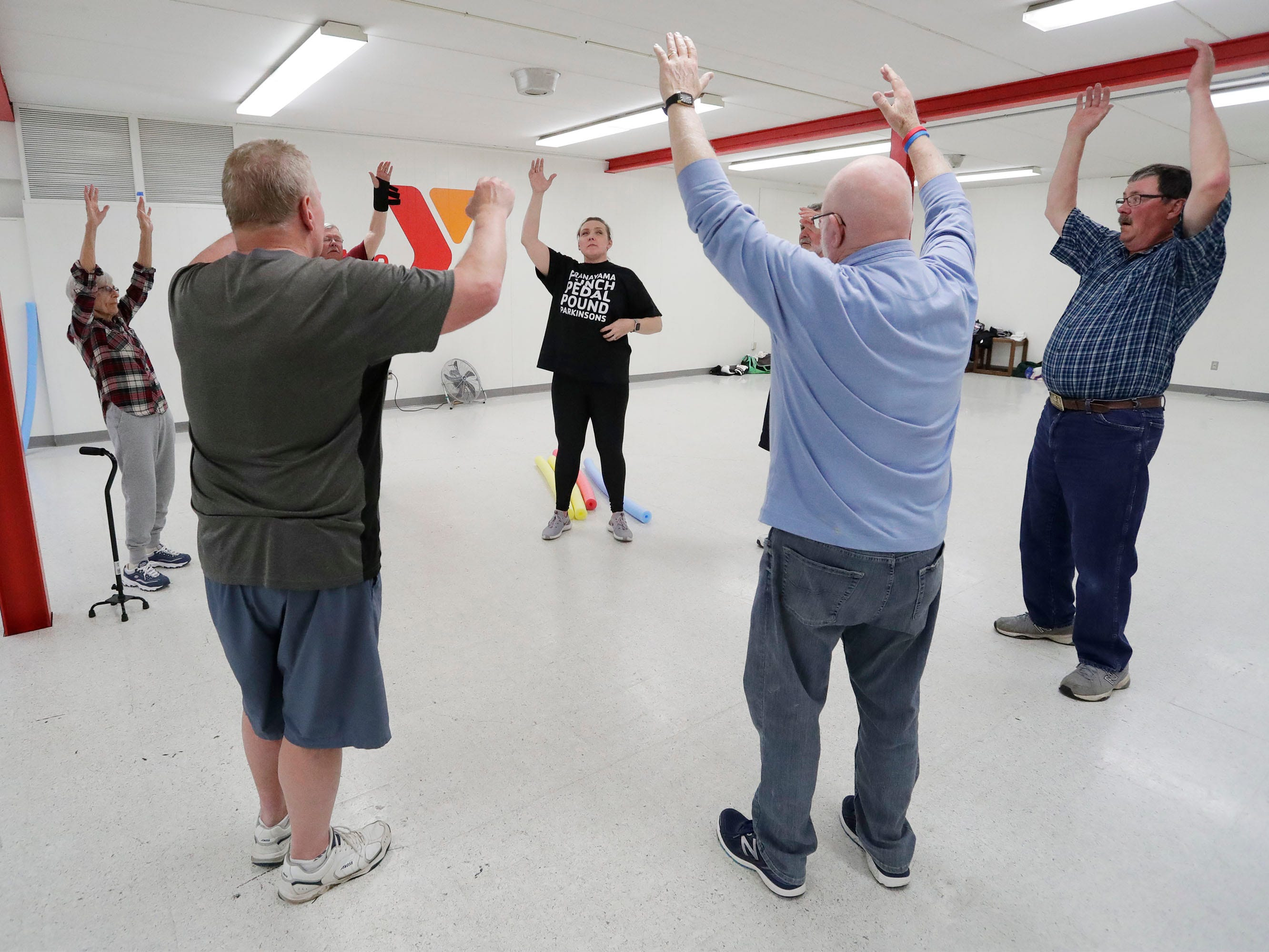 YMCA Fighting Parkinson's instructor Jana Adams works a cool down stretch with members of the class at the YMCA, Tuesday, March 26, 2019, in Sheboygan, Wis.
