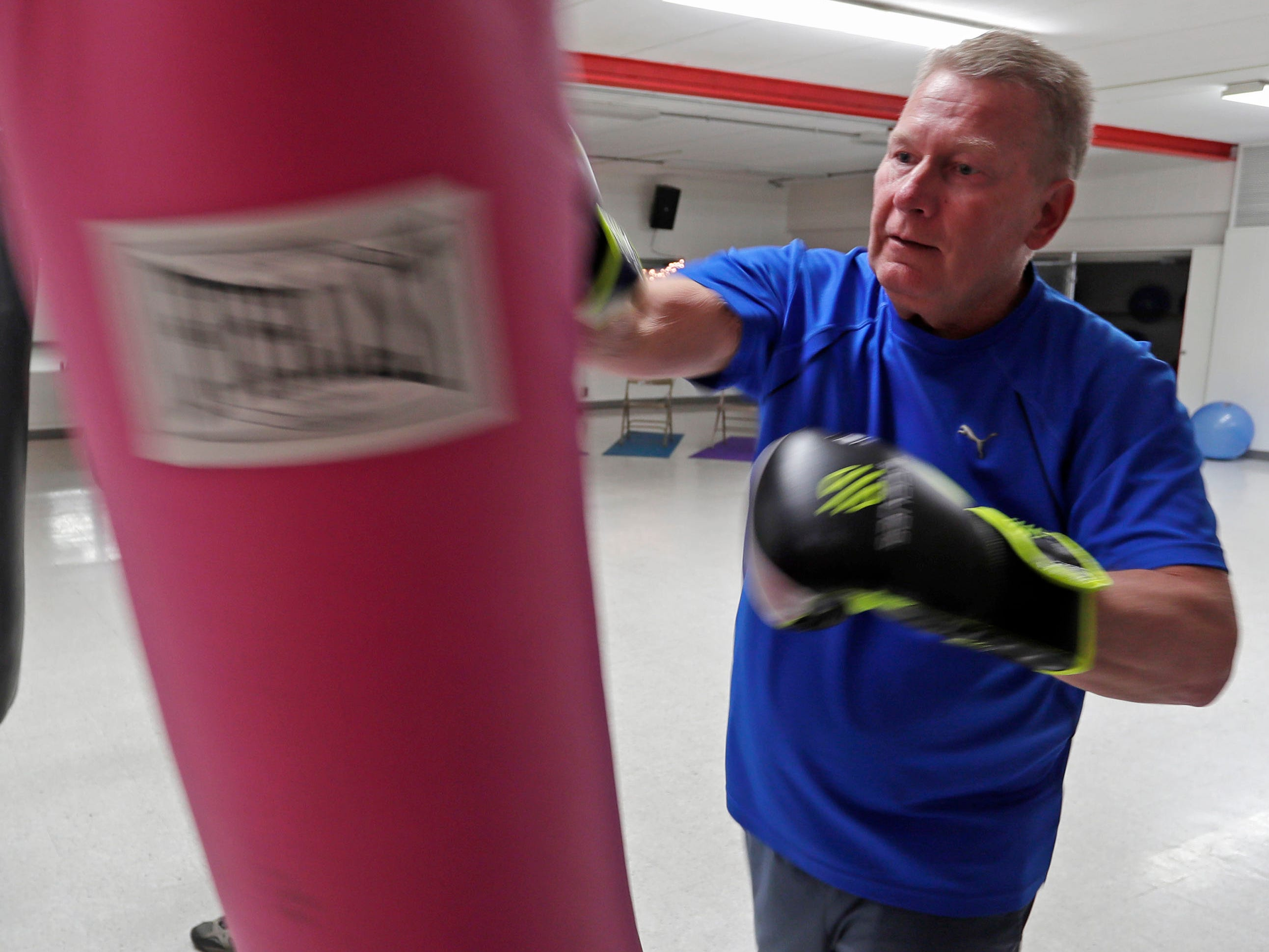 Kevin Mey of Kiel, Wis., practices his motor skills on a punching bag during the Fighting Parkinson's class at the Sheboygan YMCA, Thursday, March 21, 2019, in Sheboygan, Wis.