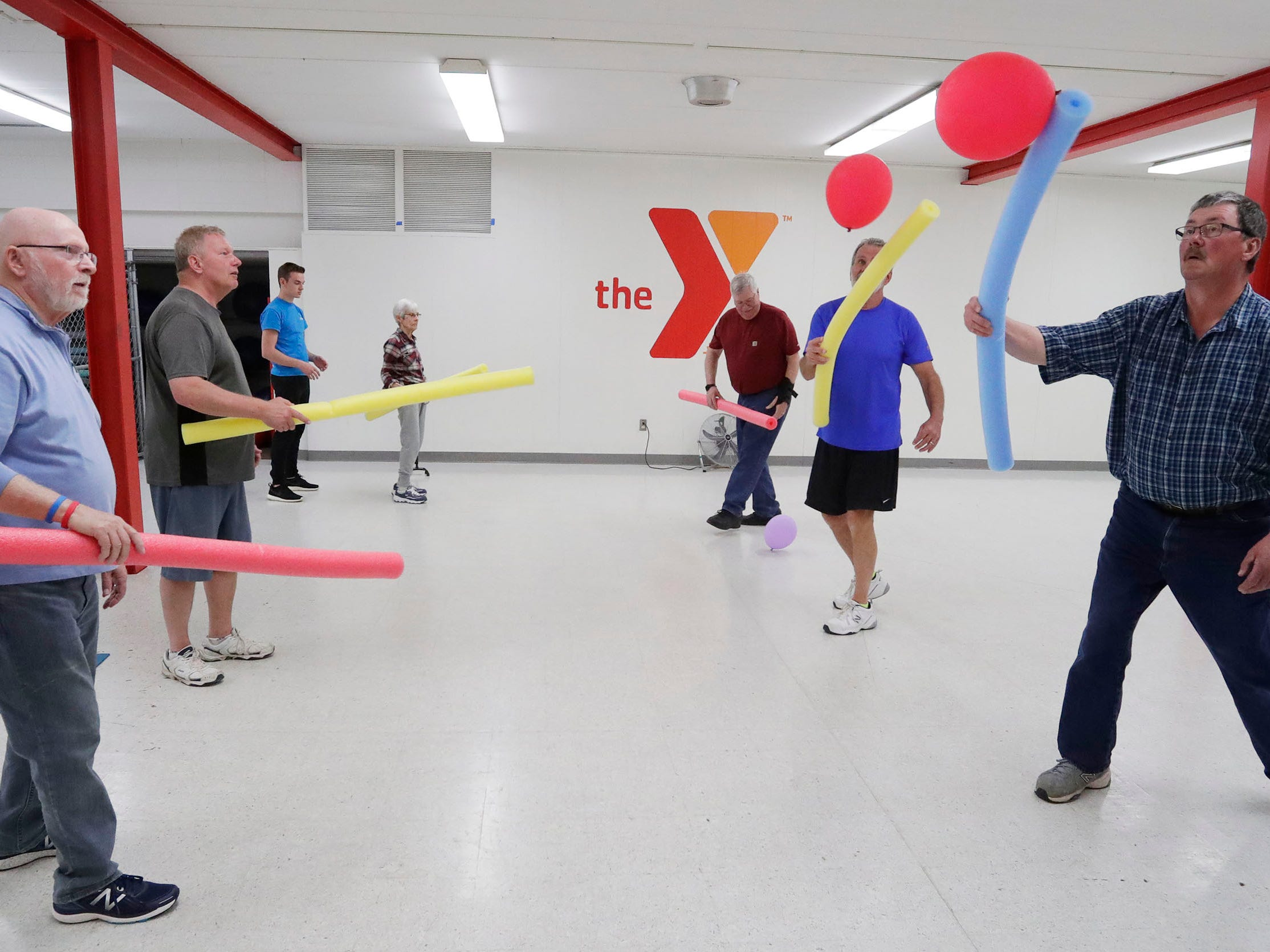YMCA Fighting Parkinson's class members Ken Pipping, left and Greg Van Helden, work on motor skills during the class, Tuesay, March 26, 2019, in Sheboygan, Wis.