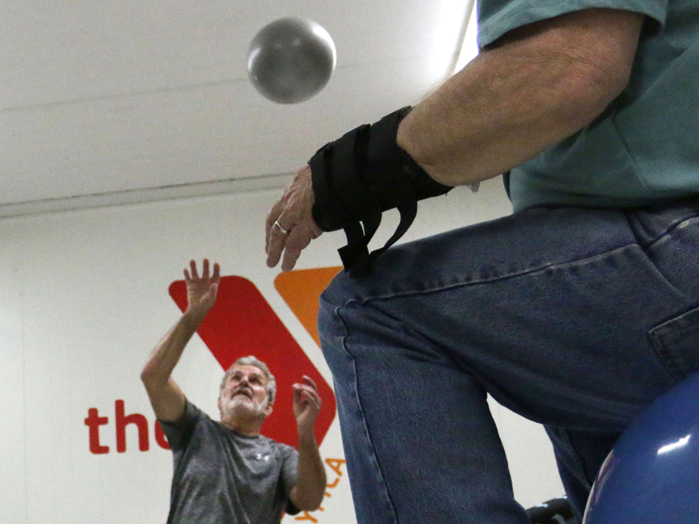 Larry Boll of Sheboygan, hits a balloon skyward during a motor control class during the YMCA Fighting Parkinson's, Thursday, March 21, 2019, in Sheboygan, Wis.