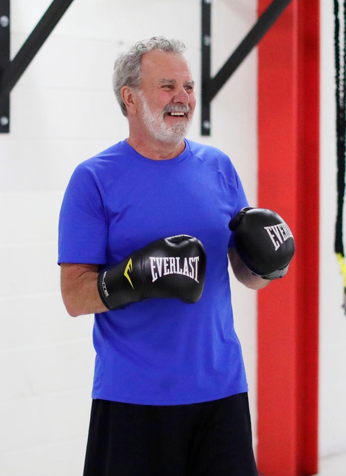 Larry Boll of Sheboygan, gets in a smile, during the Fighting Parkinson's class, Tuesday, March 26, 2019, in Sheboygan, Wis.