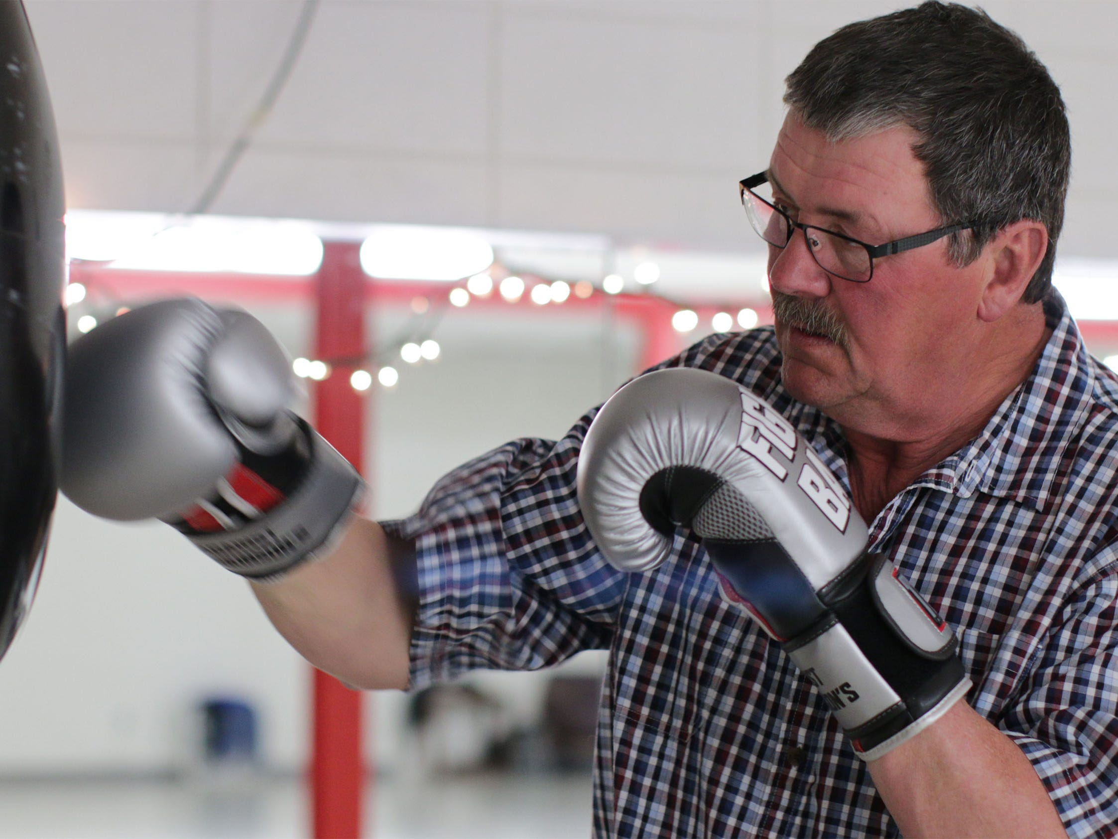 Greg Van Helden of Sheboygan hits the punching bag during the Fighting Parkinson's YMCA, Thursday, March 21, 2019, in Sheboygan, Wis.