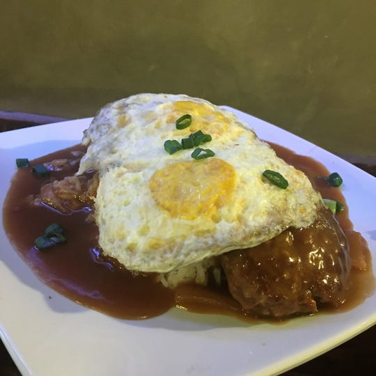 Loco Moco at Ono's Hawaiian Grill. Seared burger patties are served over rice and smothered with a rich onion and beef gravy and topped with fried eggs.