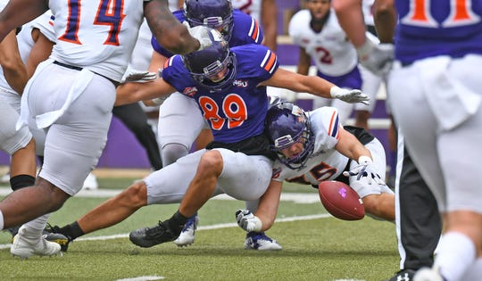 Northwestern State's Kyle Moore looks to recover a fumble in the Demons' spring game.