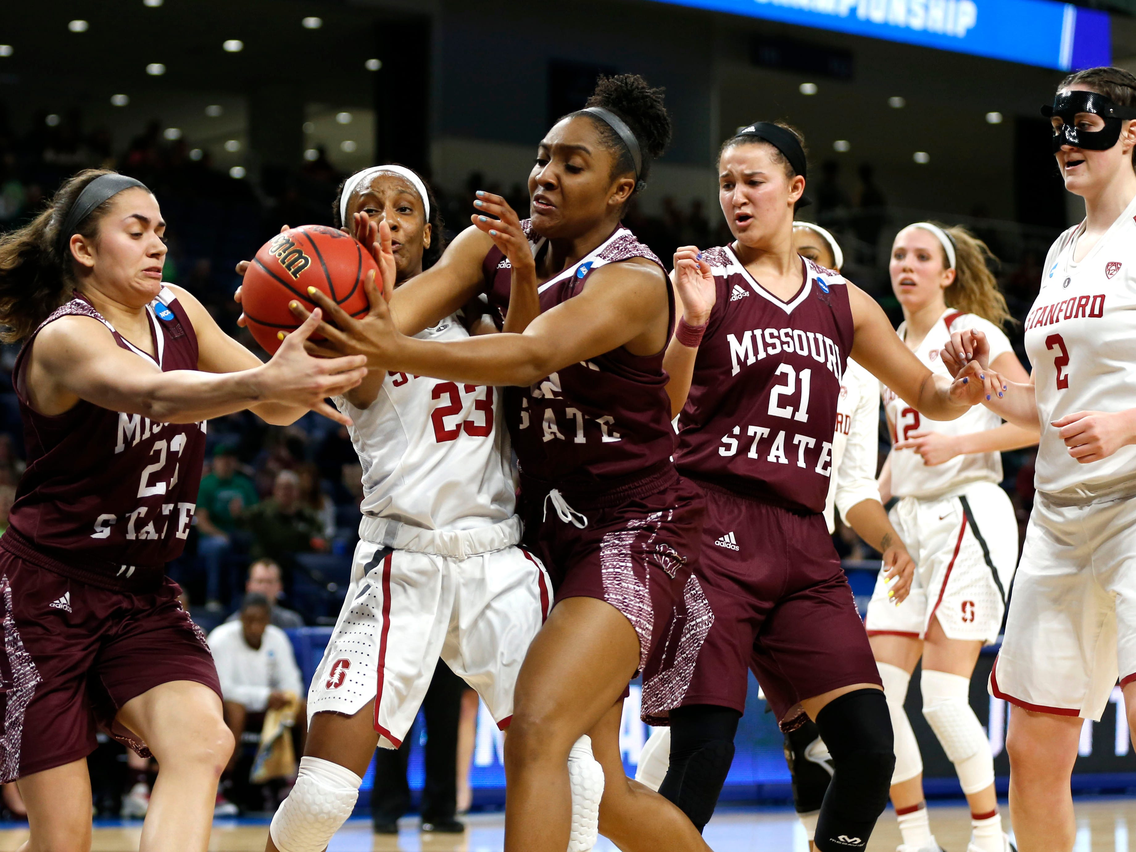 Missouri State's Jasmine Franklin (center) and Mya Bhinhar (left) fight for control of a ball with Stanford Cardinal Kiana Williams during the NCAA Division I Women's Regional at Wintrust Arena in Chicago, Ill. on Saturday, March 30, 2019.