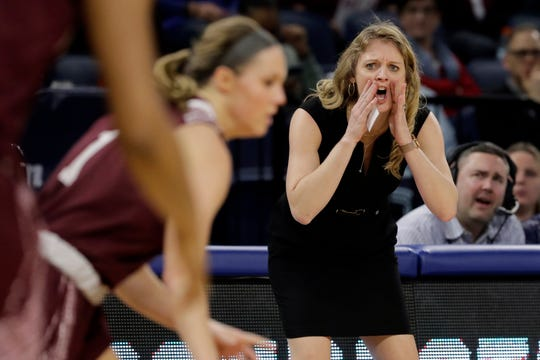Missouri State head coach Kellie Harper directs her players during the first half of a regional semifinal game against the Stanford in the NCAA women's college basketball tournament, Saturday, March 30, 2019, in Chicago.