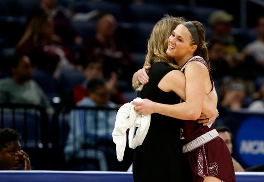 Missouri State Lady Bear Danielle Gitzen gets a hug from head coach Kellie Harper when she was removed from the NCAA Division I Women's Regional with 11 seconds left at Wintrust Arena in Chicago, Ill. on Saturday, March 30, 2019.