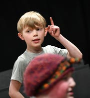 """Blake Hogenson follows along with fellow cast members during a rehearsal of GREAT Theatre's """"Joseph and the Amazing Technicolor Dreamcoat"""" Thursday, March 28, in Waite Park."""