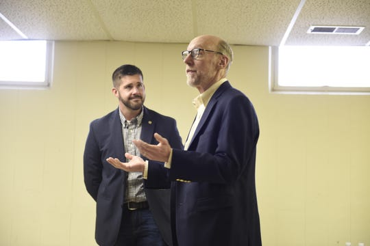 Rep. Dan Wolgamott looks on as Rep. Jim Davnie, education finance committee chair, talks about proposed funding increases at a town hall at Promise Neighborhood of Central Minnesota Sunday, March 31 in St. Cloud.