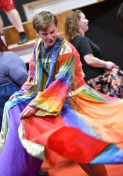 """Cast members perform during a rehearsal of GREAT Theatre's """"Joseph and the Amazing Technicolor Dreamcoat"""" Thursday, March 28, in Waite Park."""