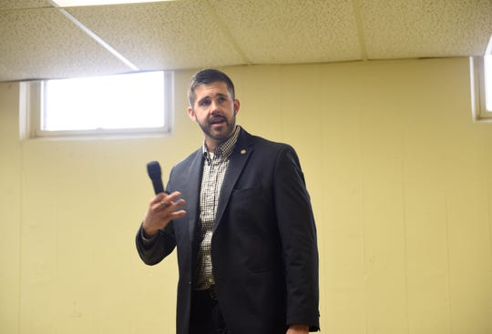 Rep. Dan Wolgamott addresses the crowd at his first town hall as an elected representative, Sunday, March 31 in St. Cloud.
