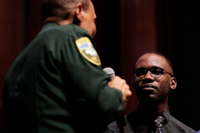 """Joel Thompson, composer of """"Seven Last Words of the Unarmed,"""" discussed how he created the musical piece with Leon County Sheriff Walter McNeil during Ode to Understanding, a musical event to inspire civil discourse at Ruby Diamond Concert Hall Sunday, March 31, 2019."""