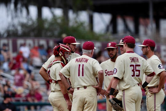 FSU manager Mike Martin talks with his infield during the Seminoles' 8-0 loss to Boston College on March 31, 2019
