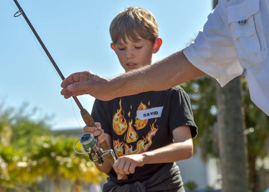 The Florida Oceanographic Society's 8th annual Game Fish and Fish Games Youth Fishing Clinic on Sunday, March 31, 2019, at the Florida Oceanographic Society Coastal Center in Stuart. The free clinic for children ages 8-14 brought together 60 participants to go through seven activity stations to learn about casting, knot tying, cast netting, lures and tackle, fish filleting, and fish identification, along with proper fishing techniques and ethics, with the help from members of the Stuart Rod and Reel Club.