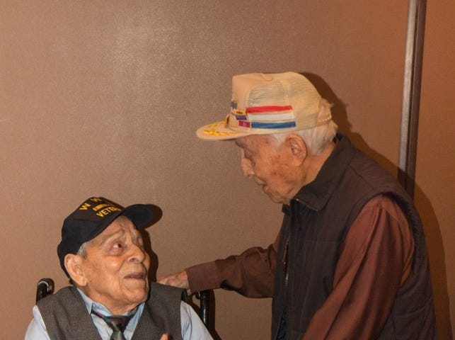 Daniel S. Fernandez, left, is greeted by his younger brother, Eliseo Fernandez, who is in his mid-90s, during his 100th birthday party Saturday, March 30, 2019, at Fort Bliss. Both served in World War II.