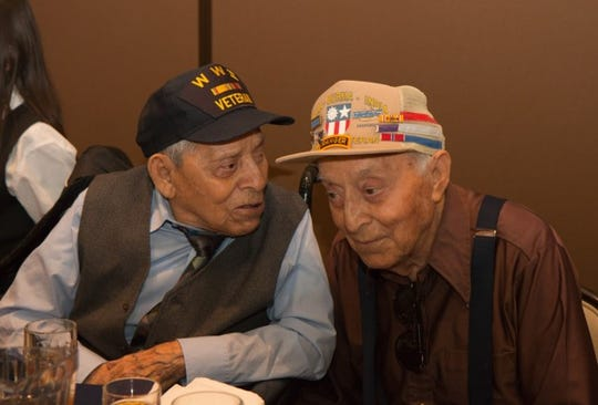 Daniel S. Fernandez, left, chats with his younger brother, Eliseo Fernandez, during his 100th birthday party Saturday, March 30, 2019, at Fort Bliss.