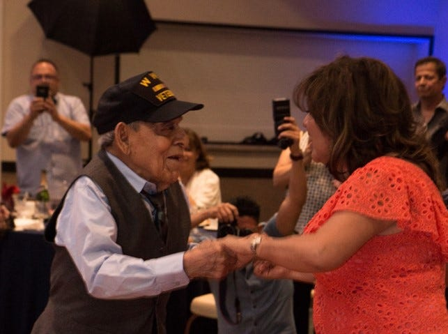 Daniel S. Fernandez dances with his daughter, Lily Fernandez, during his 100th birthday party Saturday, March 30, 2019, at Fort Bliss.