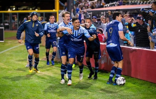 Edson Partida celebrates his second goal against Orange County SC Saturday night at Southwest University Park
