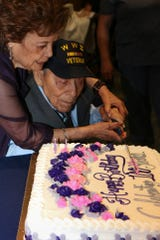 Daniel S. Fernandez cuts his 100th birthday cake with the help of his wife, Margaret Fernandez, on Saturday, March 30, 2019, at Fort Bliss. They have been married almost 72 years.