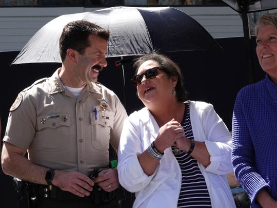 Karen Helus, widow of slain Ventura County Sheriff's Sgt. Ron Helus, talks with Sheriff Bill Ayub at an event honoring first responders Sunday in Thousand Oaks.