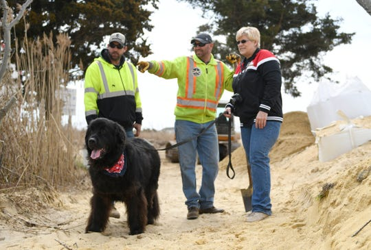 Nancy Patterson, manager of the East Point Lighthouse, checks on the progress of rebuilding the dune structure on Friday, March 29, 2019.